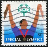 Athlet. UNITED STATES - CIRCA 2003: stamp printed by United States of America, shows Athlet with medal, circa 2003 royalty free stock photo