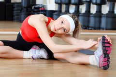 Athlete. Young sporty woman in the gym centre Royalty Free Stock Photo