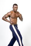 The Athlete. Muscular african american Athelete in running position Stock Photography