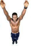 The Athlete. Muscular african american Athelete reaching up with close eyes Royalty Free Stock Photos