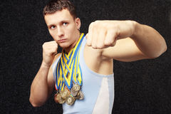 Athlete. There are many medals on the neck the athlete has Royalty Free Stock Image