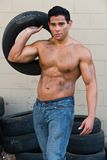 Athlete. Athletic young man with auto tires royalty free stock images