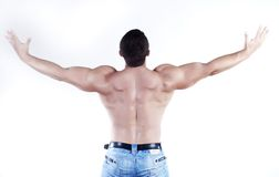 Athlete. Back of yong man athlete isolated at white background Royalty Free Stock Photography