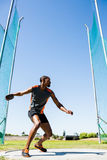 Athlete abiut to throw discus. In the stadium Stock Photos