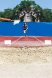 Athlete accelerates for long jump Stock Photography