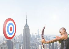 Athlete aiming at the target board against cityscape in background stock image