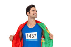 Athlete with american flag wrapped around his body Stock Images