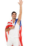 Athlete with american flag wrapped around his body Stock Photography