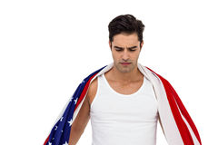 Athlete with american flag wrapped around his body Royalty Free Stock Photos