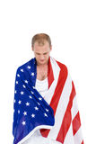 Athlete with american flag wrapped around his body Stock Photo