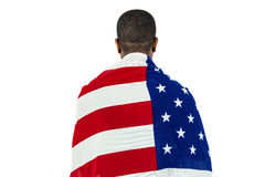 Athlete with american flag wrapped around his body Royalty Free Stock Photo
