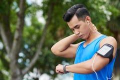 Athlete analyzing fitness tracker data Stock Image
