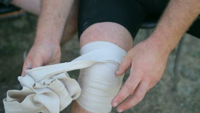 Athlete athletic relieve knee bandages after the competition