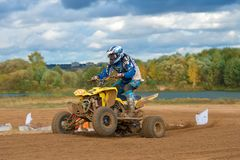 Athlete on the ATV. SERPUKHOV, RUSSIA - OCTOBER 7, 2017: Dan`kov Vladimir 42,  Class ATV, in the 4 stage  MX series, the Red Wings Cup 2017 super country-cross Royalty Free Stock Photography