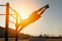 Athlete on a bar royalty free stock image