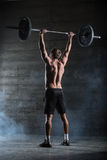Athlete with barbell. Stock Photo