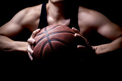 Athlete with a basketball. An athlete getting ready to throw a basketball into the basketball hoop stock images