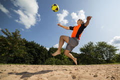 Athlete in beachsoccer. Athlete playing beach soccer, age 44, male, caucasian, shot in 73614 Schorndorf, Germany Stock Image