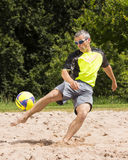 Athlete in beachsoccer. Athlete playing beach soccer, age 44, male, caucasian, shot in 73614 Schorndorf, Germany stock photo