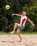 Athlete in beachsoccer. Athlete playing beach soccer, age 44, male, caucasian, shot in 73614 Schorndorf, Germany stock photography
