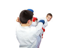 The athlete beat a punch arm against punch kicking Royalty Free Stock Photos