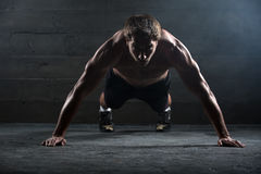 Athlete with a beautiful body and naked torso Royalty Free Stock Photo