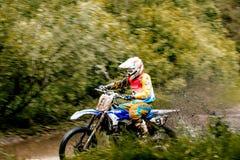 Athlete bike enduro riding puddle of water and mud Royalty Free Stock Photos