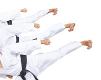 An athlete with a black belt is beating three high kick collage Stock Photos