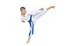 An athlete with a blue belt beats kick Yoko geri Stock Image