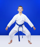Athlete with a blue belt is in the rack karate Royalty Free Stock Photos
