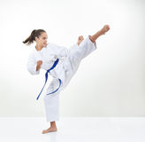 An athlete with a blue belt trains a kick royalty free stock images
