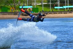 The athlete with board hold on to the rope and the boat accelerates. Russia, Volgodonsk - June 18, 2015: Water snowboard. The athlete with snowboard hold on to Stock Photography