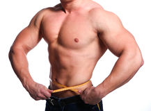 Athlete body of man. Strong young body of athlete man with centimeter Royalty Free Stock Images