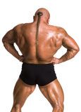 Athlete bodybuilder demonstrating muscles of the back and arms Stock Images