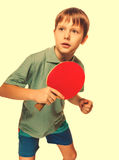 Athlete boy child teenager with racket plays table tennis ping p Stock Image