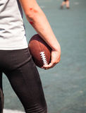 Athlete with broken elbows keeps the ball Royalty Free Stock Images