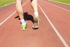 Athlete with broken green running shoes Stock Photo