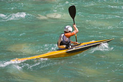 Athlete in a canoe. On the river Royalty Free Stock Photos