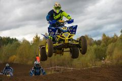 Athlete by car in flight. SERPUKHOV, RUSSIA - OCTOBER 7, 2017: Yarovoy Evgeniy 6,  Class ATV, in the 4 stage  MX series, the Red Wings Cup 2017 super country Stock Image