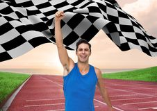 Athlete celebrating her victory with checkered flag on race track. Digital composition of athlete celebrating her victory with checkered flag on race track Stock Photos