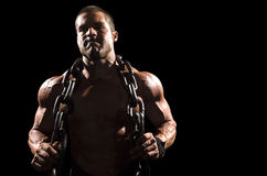 Athlete with chains color to the left Royalty Free Stock Image