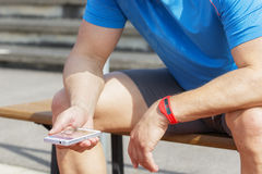 Athlete checking fitness data wearable Stock Image