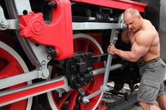 Athlete checks locomotive condition Stock Photos