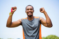 Athlete cheering with gold medal Royalty Free Stock Photos