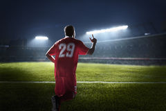 Athlete cheering in a stadium at night Stock Photography