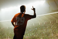 Athlete cheering in a stadium at night Stock Photos