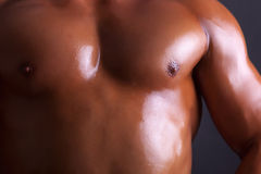 Athlete chest of man on black background Stock Images