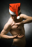 The athlete in a christmas cap Stock Images