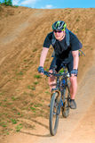 Athlete on a clay road cycling Royalty Free Stock Photo
