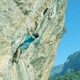 Athlete climbing on severe overhanging Rock old style toned Royalty Free Stock Photo